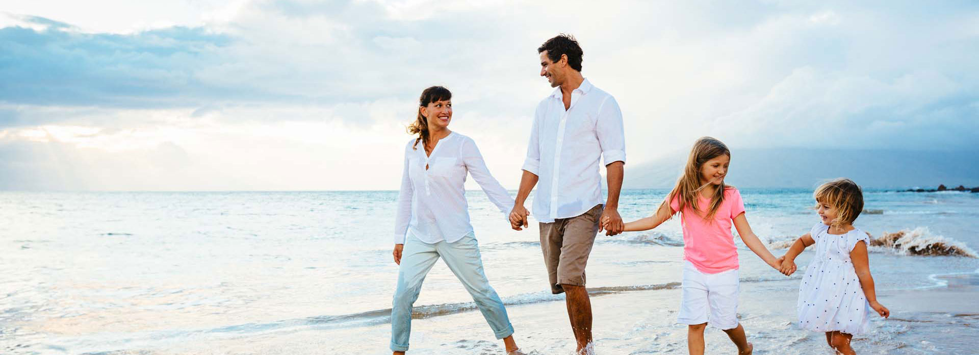 A happy family walking on a beach